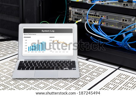 Laptop in network data center, server room. Using for monitoring server computer performance. #187245494