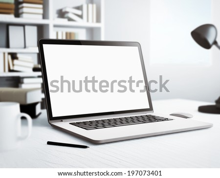 Laptop in white room
