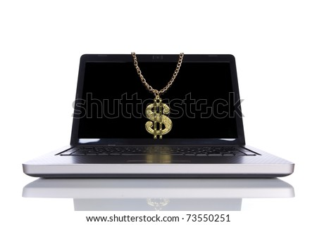 laptop isolated on white with a golden dollar symbol (selective focus)