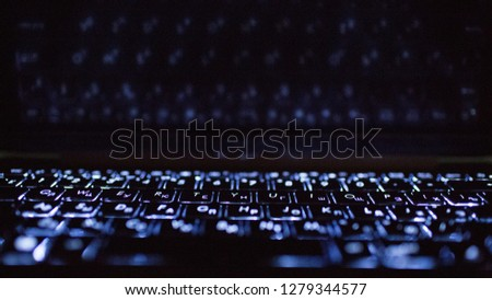 Laptop keyboard and its reflection. #1279344577