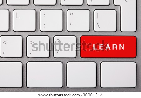 "Laptop keyboard and red key ""LEARN"" on it. - stock photo"