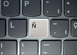 laptop keyboard in gray tones with the letter ñ of the Spanish keyboard highlighted