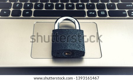 Laptop Keyboard With Locker concept photo protected locked virus protection password protection hacker attack #1393161467