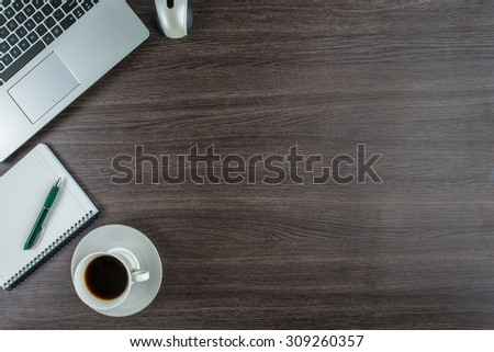 Laptop, notebook and pen with coffee cup on work desk