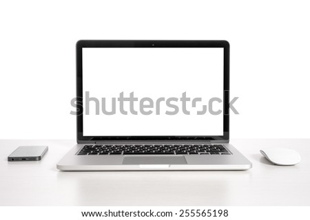 Laptop on a light table with a mouse and a telephone #255565198