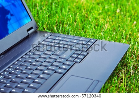 Laptop on grass. Shallow DOF