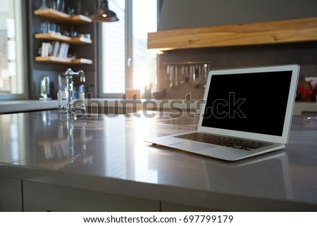Laptop on kitchen counter at home #697799179