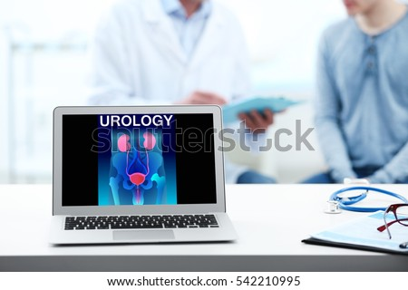 Shutterstock Laptop on table. Urinary system and word UROLOGY on screen. Health care concept.