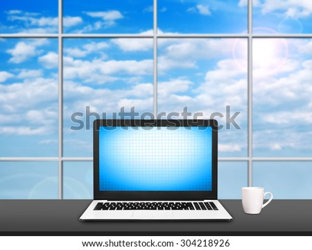 Laptop on table with blank screen and coffe cap