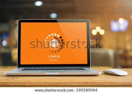 Laptop on table with loading bar load waiting on digital display,  indicator concept. #590589044
