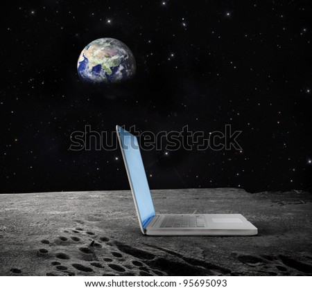 """Laptop on the Moon with Earth in the background """"Elements of this image furnished by NASA"""""""