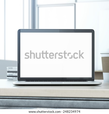 Laptop on the wooden table