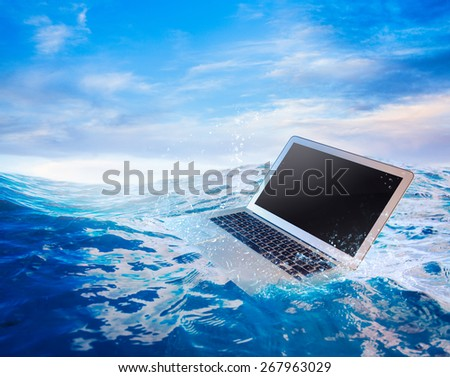 laptop on water/ damaged computer