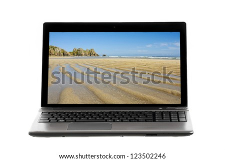 Laptop on white background showing landscape image on screen.