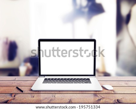 Laptop on wood table in office #195751334