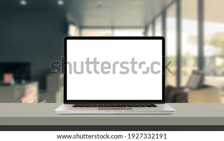 Laptop or notebook with blank screen on service counter in blurry background with parcel delivery office express, EMS.