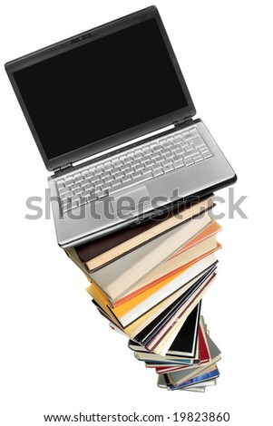 Laptop over books stack isolated over white background