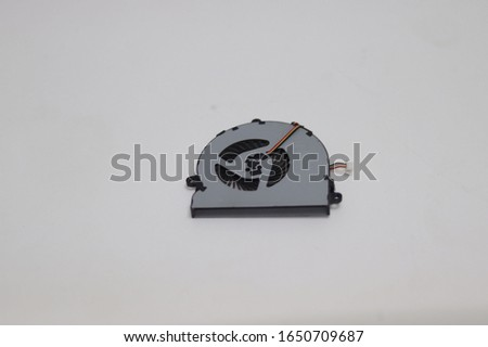 Laptop processor cooling fan over isolated white blurry background.single cooling fan with wire and modules.Processor cooling fan reduces the heat temperature inside a pc
