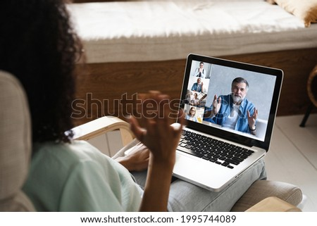 Laptop screen over woman shoulder view, communication group videocall conversation