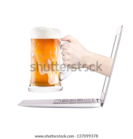 Laptop side view. beer toasting to show internet business success