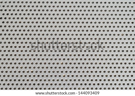 Laptop Speaker Hole grid metallic pattern macro with dust inside the holes