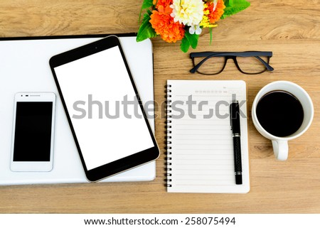 Laptop, Tablet and cup of coffee with flower on desk