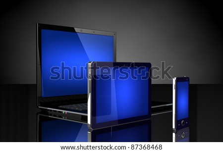 Laptop, tablet and mobile phone  with blue screens on black
