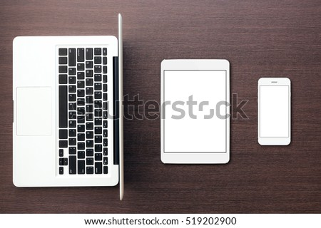 laptop tablet and phone on desk top view, mock-up tablet and phone