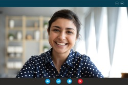 Laptop web cam view head shot of indian woman. E-date online services, video call using phone or pc, distance chat with mates common task, conversation between friends, job interview remotely concept