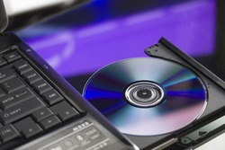 Laptop with a disk dvd.