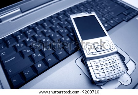 laptop with a mobile phone