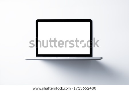 Laptop with blank screen mockup concept. Creative workspace background.