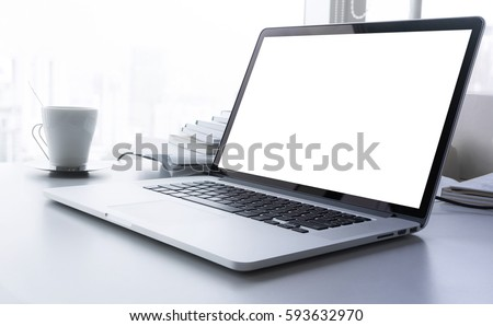 Laptop with blank screen on desk with big window in modern office.business idea concept #593632970