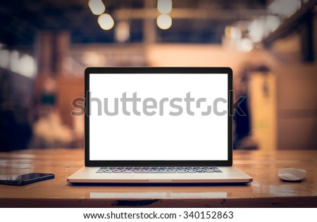 Laptop with blank screen on table. - Shutterstock ID 340152863