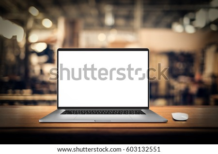 Laptop with blank screen on table #603132551