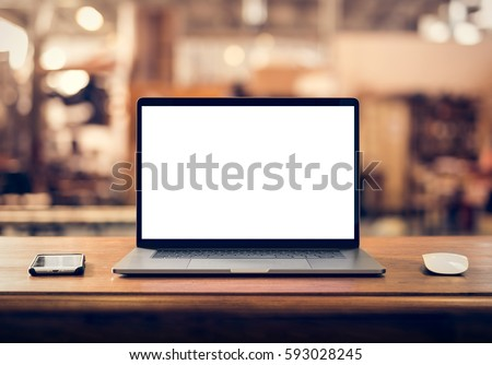 Laptop with blank screen on table in industrial interior #593028245