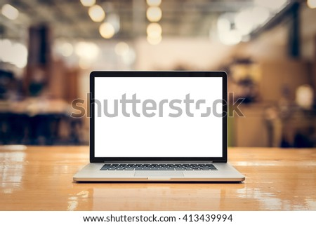Laptop with blank screen on table - whole laptop is sharp.