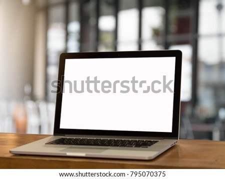 Laptop with blank screen on wooden table. Coffee shop or resturant blurred background. #795070375