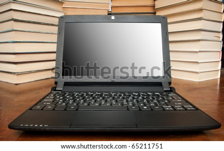 Laptop with books isolated on white background. wide angle.
