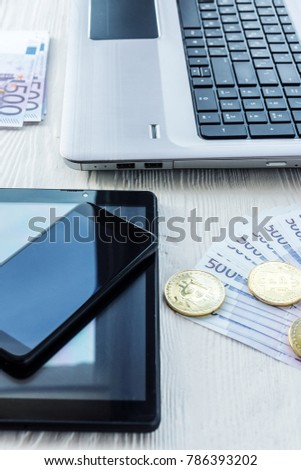 Laptop with cash and bitcoin on a white background #786393202