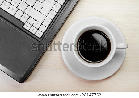 laptop with fresh cup of coffee and notebook, view from above - stock photo