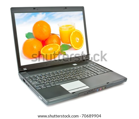 Laptop with fruit on screen isolated on white background