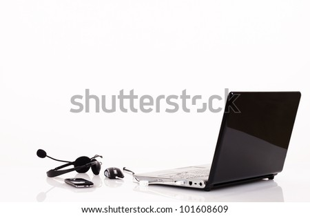 Laptop with headphones and mobile phone. Isolated on white background