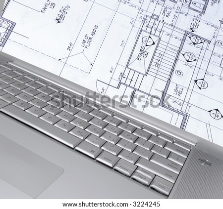 laptop with home plans on screen (my image on screen )