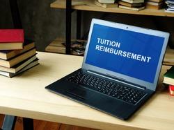 Laptop with information about Tuition Reimbursement.