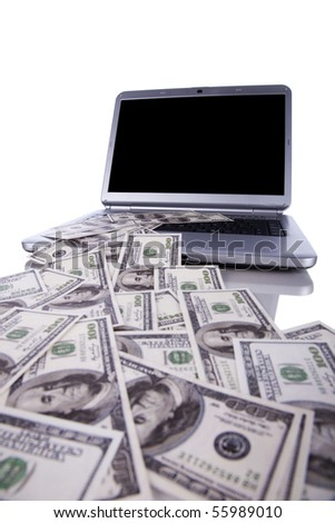 Laptop with lots od money, spending or making money concept (with copy space)