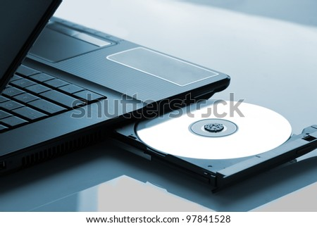 Laptop with open CD - DVD drive