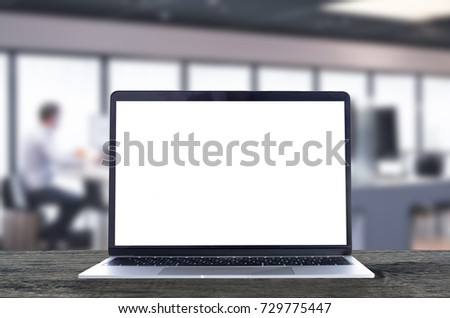 Laptop with white blank screen on wooden table in the internet cafe.