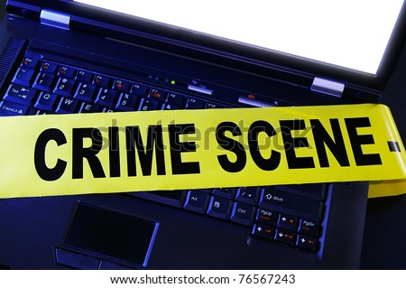 laptop with yellow crime scene tape across it - stock photo