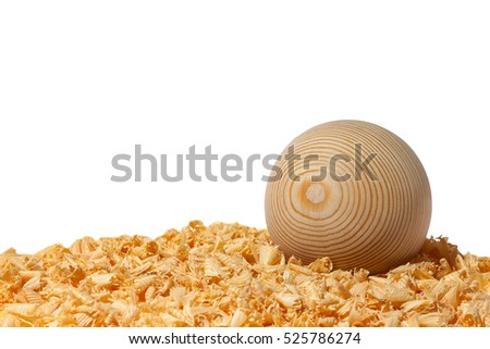 Larch wood ball on shavings of wood. Turned wood ball.